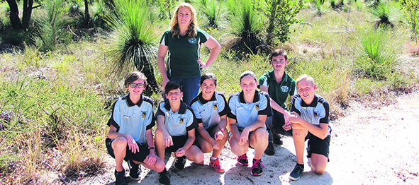Bonny Dunlop-Heague and Adrian Botha ( former student of Bullsbrook College) from Chittering Landcare with Bullsbrook College students in the school's  bushland area.