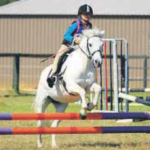Sophie Miller (8) on 'Wishes' competing in the 12 and Under 55cm Showjumping which she won. Sophie took out the overall high point rider 10 and Under.