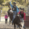 Jack Collins of Muchea – 1st in the U 18 Steer ride at the Mogumber Junior Rodeo. Luke Metcalf (recent winner of NAIDOC Perth 2017 Sportsperson of the Year) stepping in as bull fighter. Photo: EJ stock photo